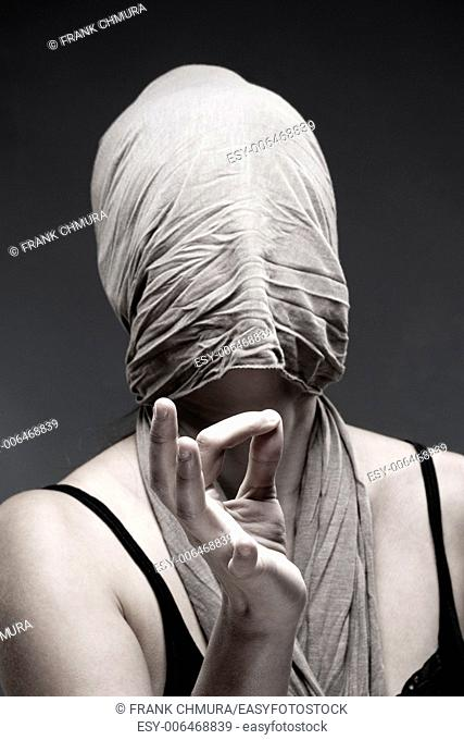 Woman Covering Face with Cloth, Making Hand Sign with Fingers
