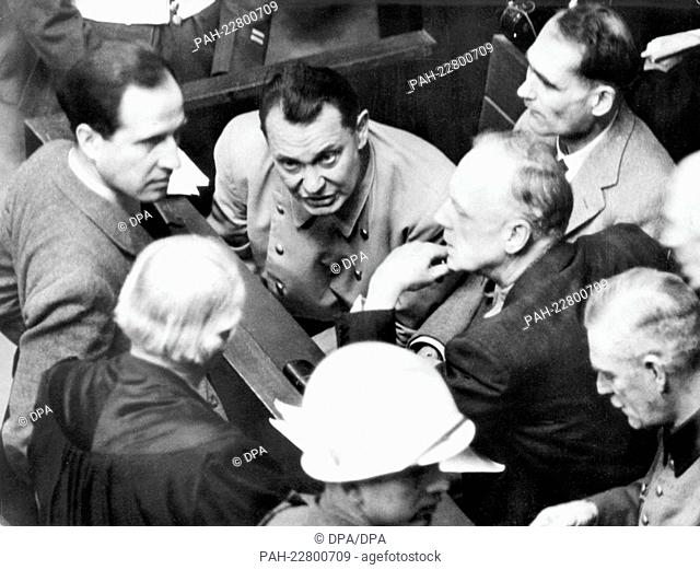 The main defendants (from left to right) Hermann Göring, Rudolf Heß and Joachim von Ribbentrop in the dock during the Nuremberg Trials against the leading war...