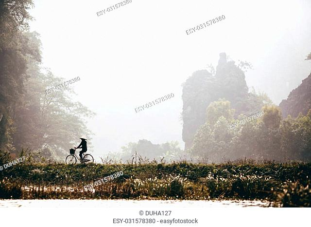 Man riding bicycle, Ha Long Bay, Vietnam