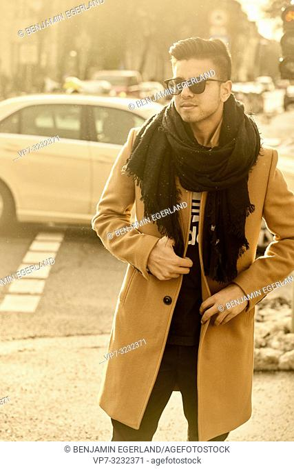 young fashionable man on street in city, male blogger with style, in Munich, Germany