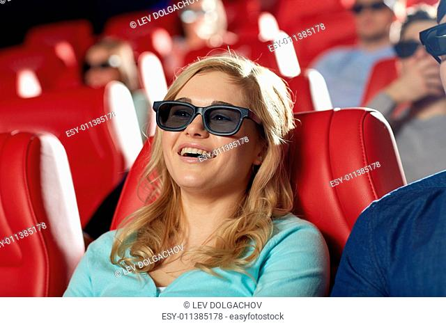 cinema, entertainment, technology and people concept - happy young woman in 3d glasses watching comedy and laughing in movie theater
