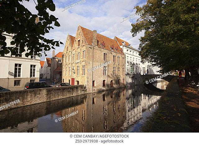Houses, reflections and bridge on the canal in the city center, Bruges, West Flanders, Belgium, Europe
