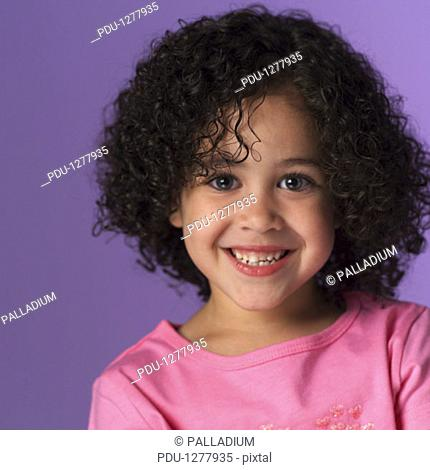 Girl (8-9) posing in studio, portrait