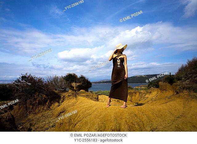 Stock Photo - Teen girl in long dress in wilderness