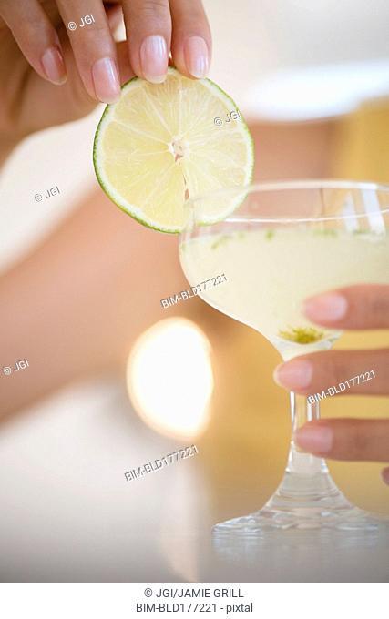 Hispanic woman drinking cocktail