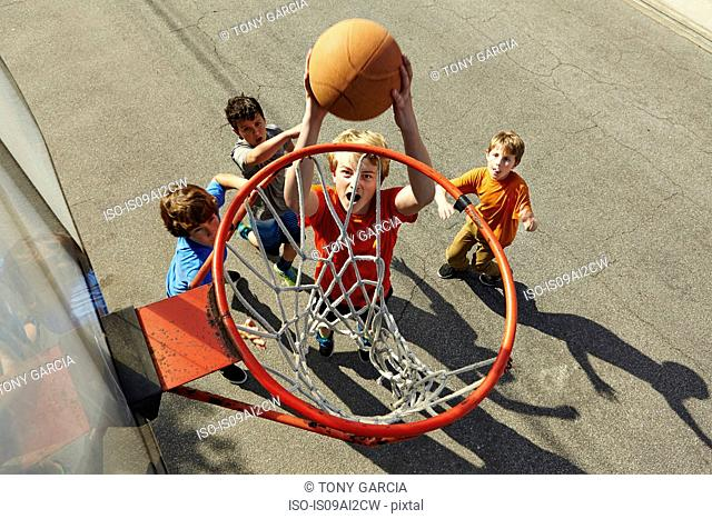 Boys playing basketball, high angle