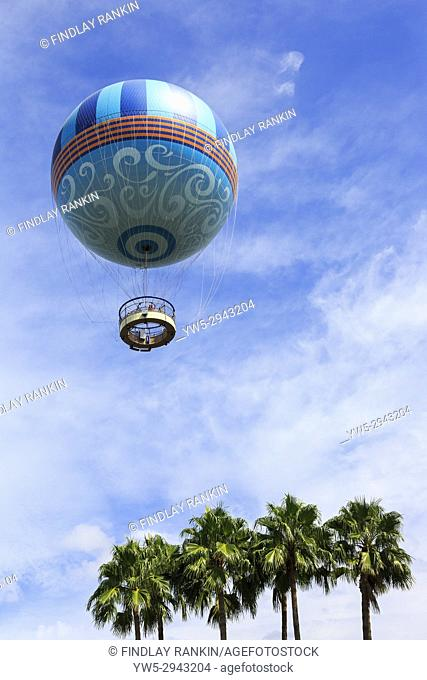 Helium filled balloon flying with tourist passengers above Disney Springs, Orlando< Florida, USA