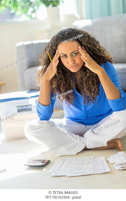Young woman dealing with home finance