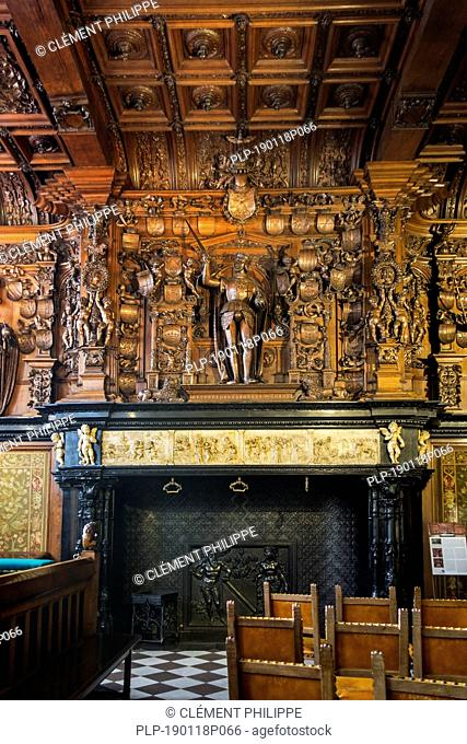 16th century fireplace and mantelpiece in Alderman's chamber at Brugse Vrije, former court of law / courthouse in the city Bruges, Flanders, Belgium