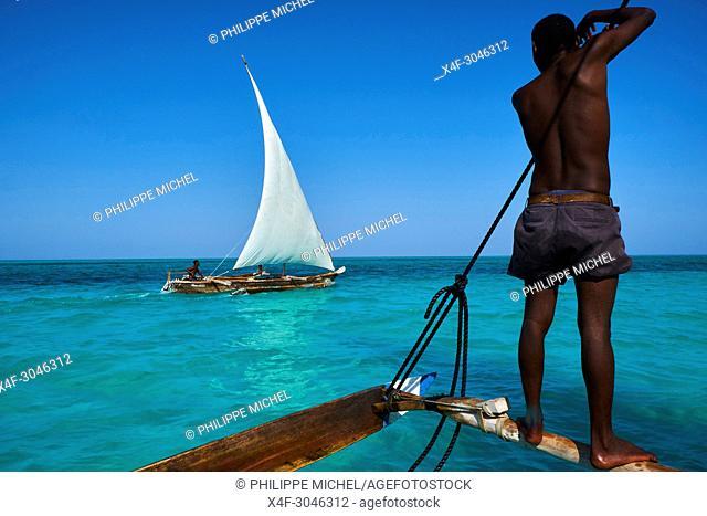 Tanzania, Zanzibar island, Unguja, fisher at Jambiani