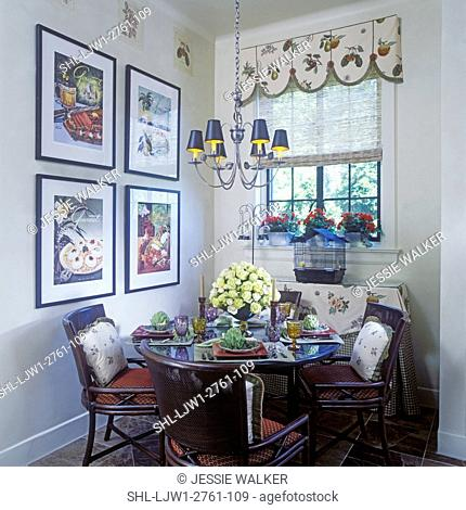 KITCHENS: Eating area, round table, cozy area, four cushioned chairs, four large framed prints of Gourmet magazine covers, black bird cage, valance at window