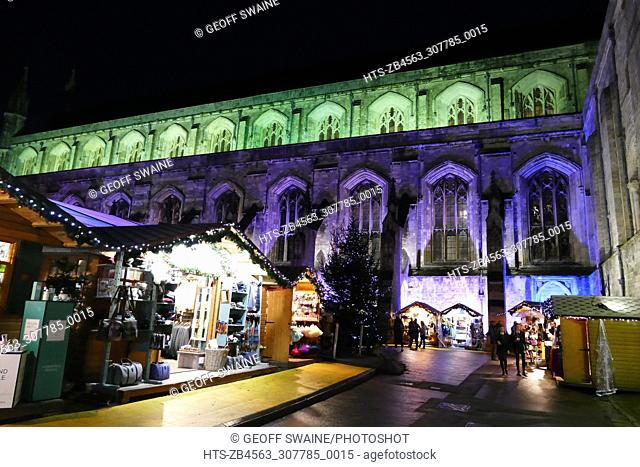 Stalls selling festive gifts in Winchester Cathedral Quad Winchester Cathedral Christmas Market Winchester Hampshire UK