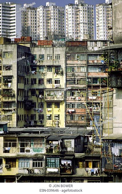 Crowding in Kowloon, high density, population, leads to, high rise, housing blocks, close together on new territories reclaimed, from sea, poverty