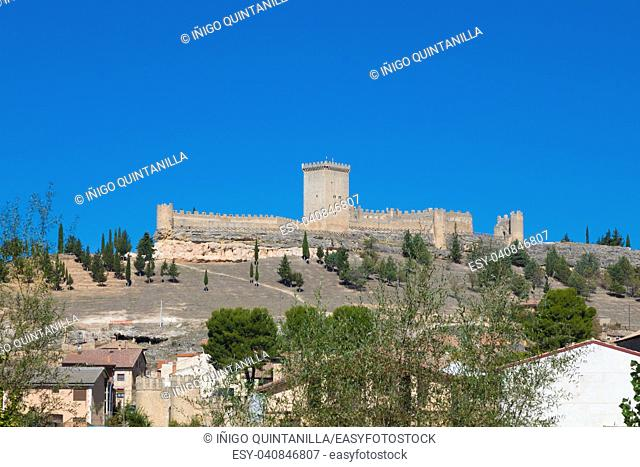 old wall and turret of castle in Penaranda de Duero village, landmark and public monument from eleventh century, in Burgos, Castile and Leon, Spain, Europe