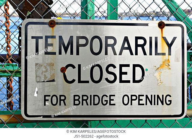 Massachusetts, Boston, Temporarily closed for bridge opening sign posted on chain link fence