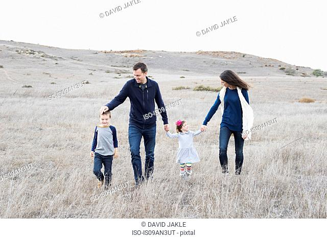 Couple and two children out walking in hilly landscape