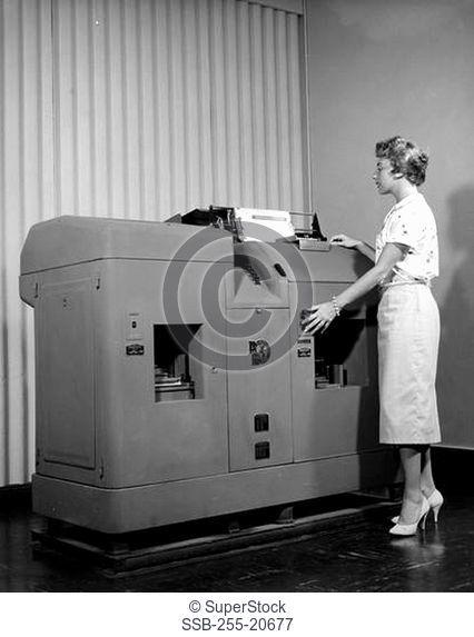 Woman operating Remington Rand Tabulating and Accounting System