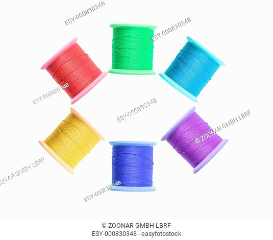 Few color thread bobbins isolated on white