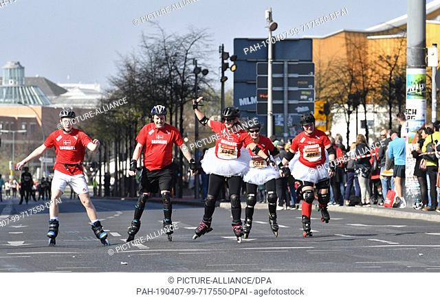 07 April 2019, Berlin: Participants are at the run of the skaters..at the Berlin Half Marathon at Potsdamer Platz in Ballettröckchen