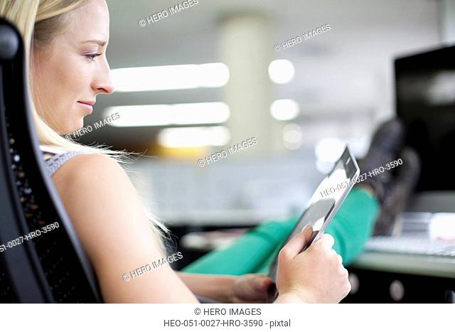 young female office worker with pc tablet