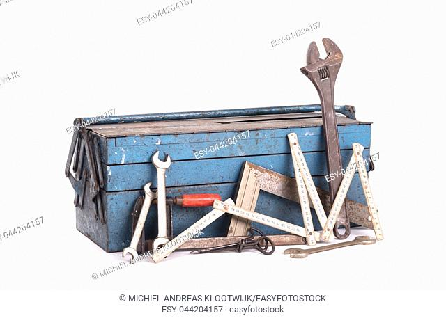 Old toolbox filled with vintage tools, isolated