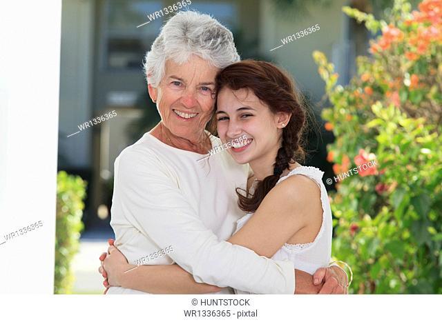 Senior woman hugging her daughter