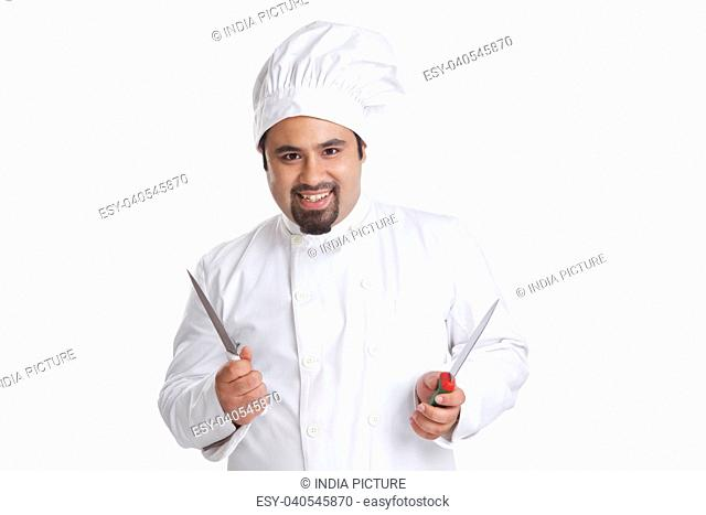 Portrait of chef holding knives