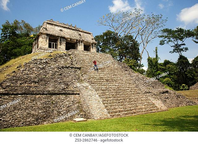 Tourist climbing down the stairs of the Temple of Conde-Templo del Conde in Palenque Archaeological Site, Palenque, Chiapas State, Mexico, Central America