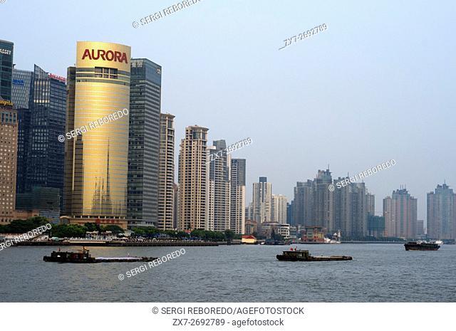 The Bund promenade, Shanghai, China. China Shanghai Tourist Shanghai Skyline viewed over the Huangpu river from the Bund