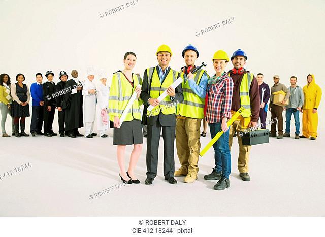 Portrait of confident construction workers
