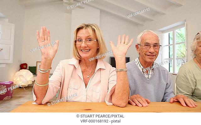Five Seniors doing waving to camera