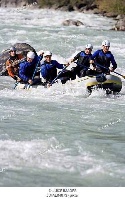 Group of people whitewater rafting