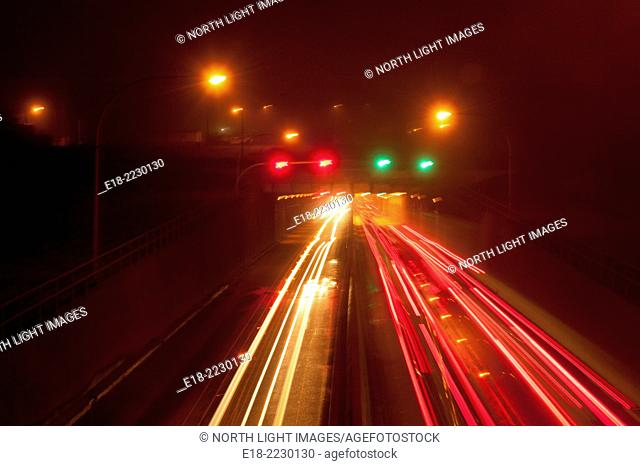 Canada, BC, Richmond. Vehicle lights entering and leaving the Massey Tunnel under the Fraser River, which links the communities of Richmond and Delta
