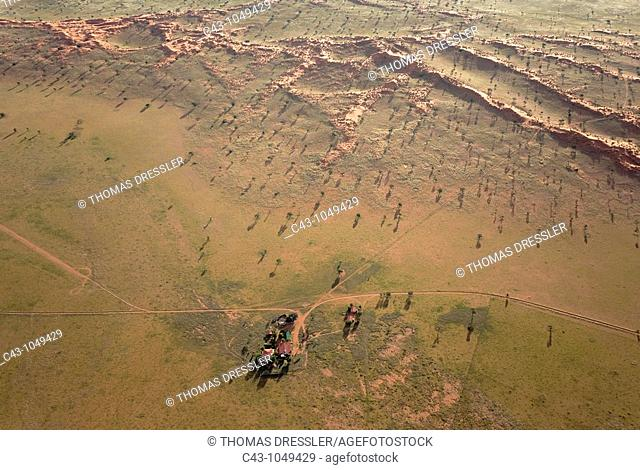 Namibia - Aerial view of the main building of the exclusive Wolwedans safari camps at the edge of the Namib Desert, surrounded by grass-grown sand dunes and...
