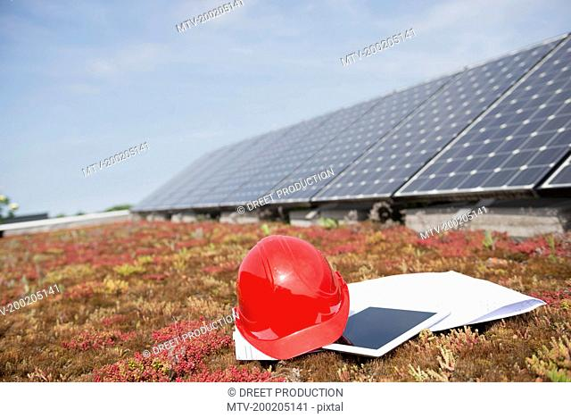 Red safety helmet Tablet computer building plan