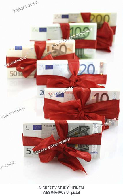Bunches of banknotes tied as gift, close-up