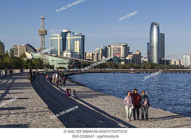 Azerbaijan, Baku, Bulvar Promenade, city skyine from Baku Bay with visitors, NR