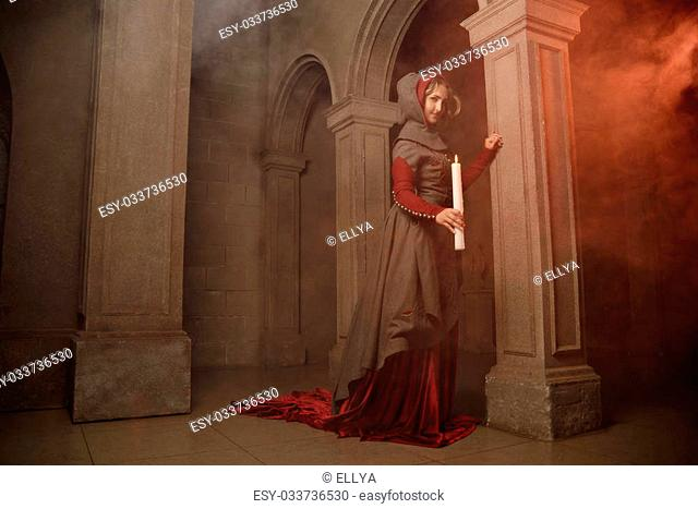 Young beautiful woman at gothic medieval caslte