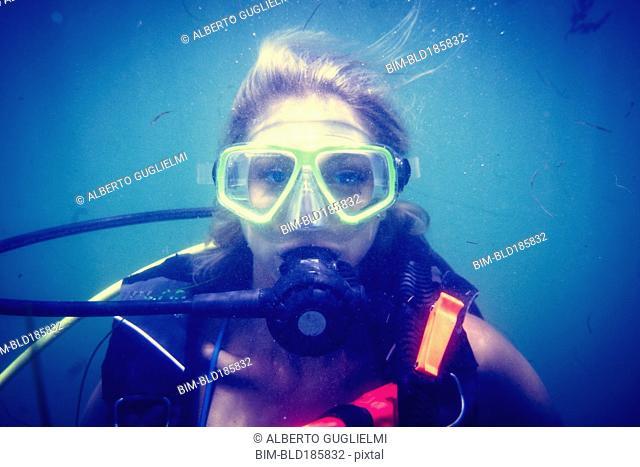 Caucasian diver swimming in ocean