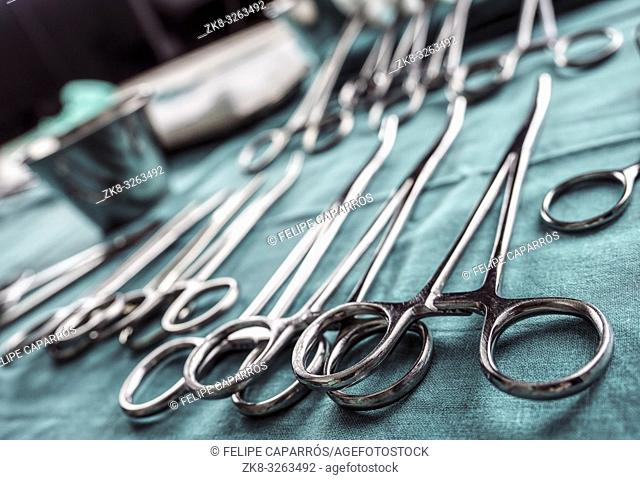 Some scissors for surgery in an operating theater, conceptual image, horizontal composition
