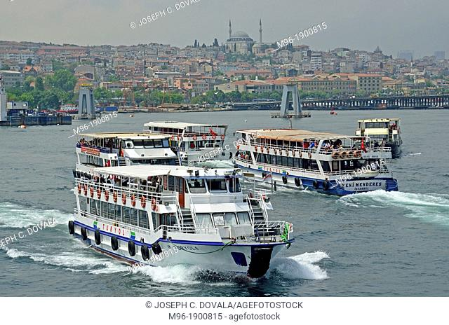 Ferry boats crossing each other on the Bosphorus, Istanbul, Turkey