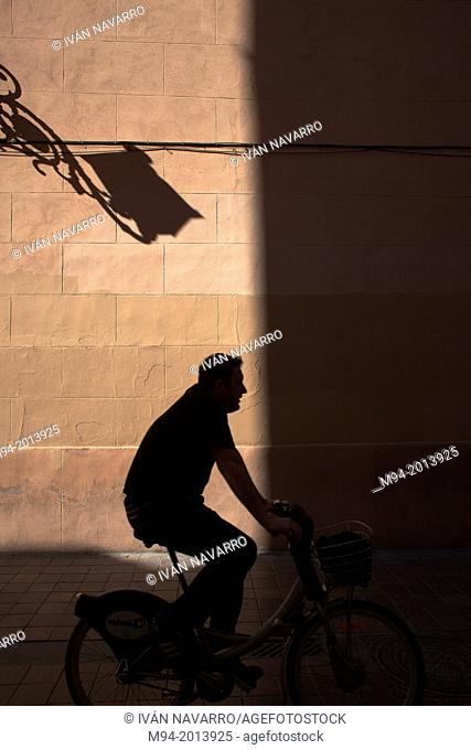 shadow of a man in a bycicle