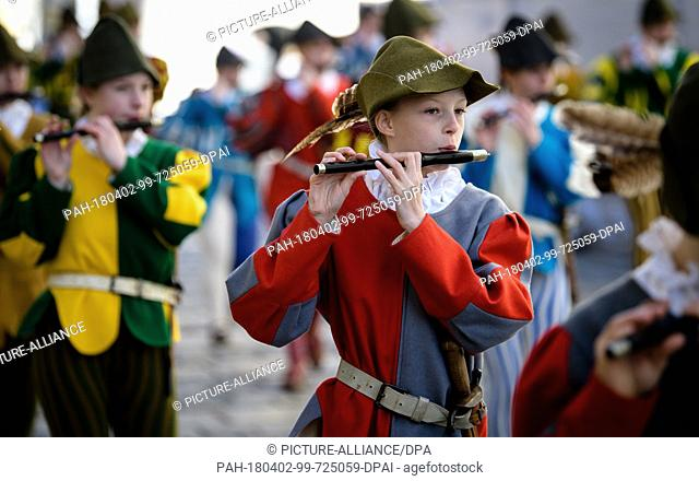 02 April 2018, Germany, Traunstein: Children of a marching band playing during the traditional Georgiritt ('Saint George's equestrian procession') to the...
