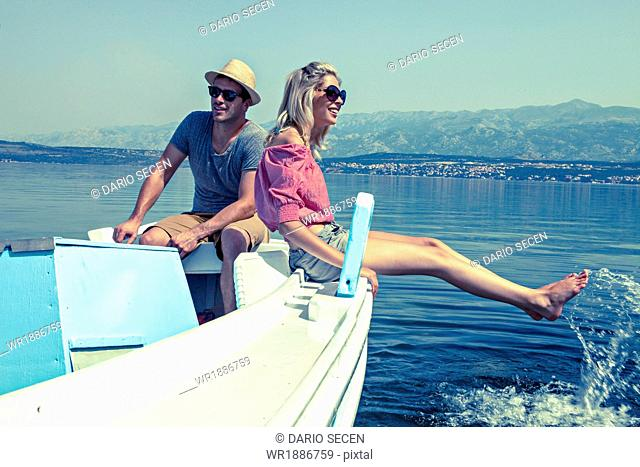 Croatia, Dalmatia, Young couple in a boat, relaxing