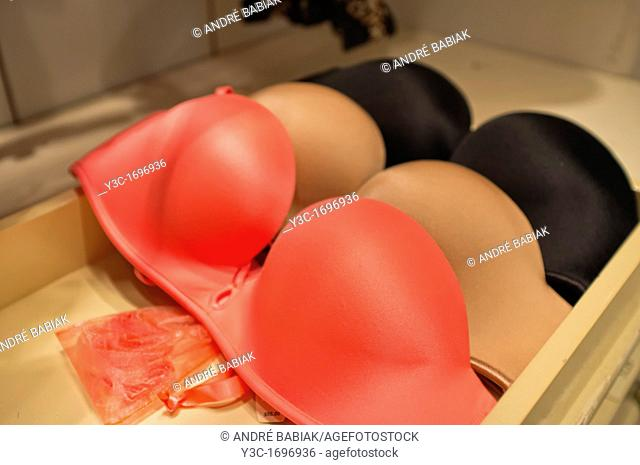 Push up bras in different colors on a store display