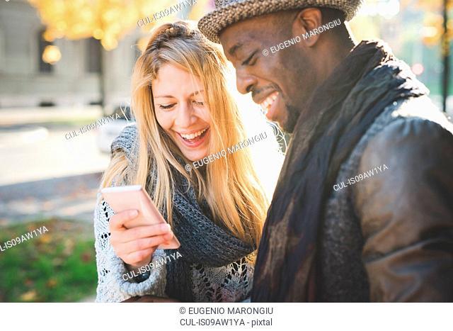 Couple using smartphone