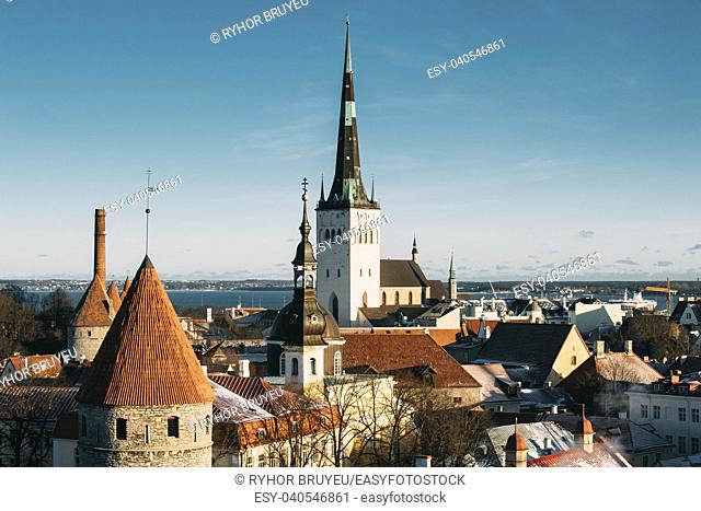Tallinn, Estonia. Part Of Tallinn City Wall With Towers, At The Top Of Photo There Is Tower Of Church Of St. Olaf Or Olav. Popular Destination Scenic