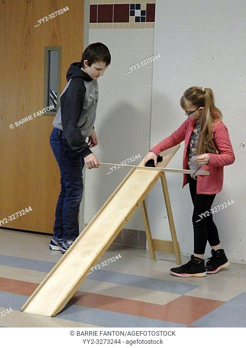 8th Grade Girl and Boy Testing Model Car, Forces and Motion Science Unit, Wellsville, New York, USA