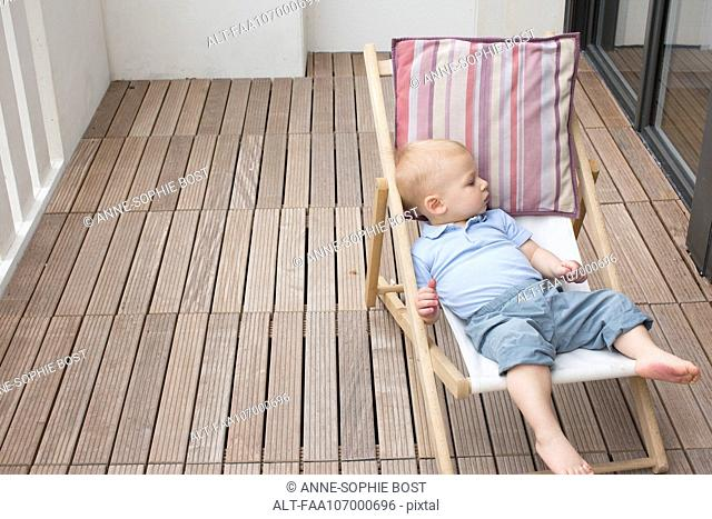 Baby reclining on lounge chair