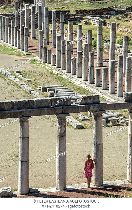 Exploring amongst the doric stoas that surround the stadium, at Ancient Messene, Messinia, Peloponnese, Greece
